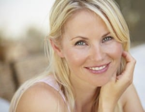 Photo of a blonde woman witth a pretty smile for Plano, TX affordable dentist Dr. Miranda Lacy.