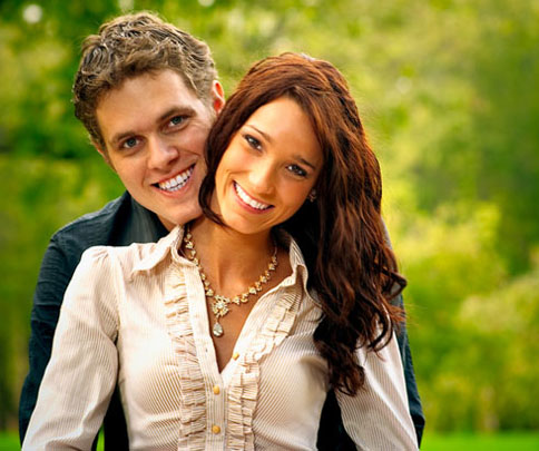 phto of happy brunette young couple for beautiful smile guarantee from Plano dentist Dr. Miranda Lacy.
