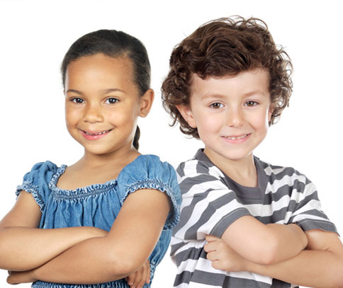 Photo of adolescent boy and girl with arms crossed for Plano dental sealants from Dr. Mirana Lacy.
