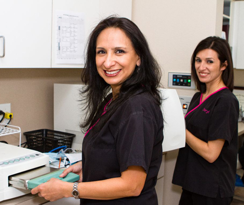 Picture of two staff members for patient information from Plano dentist Dr. Miranda Lacy.