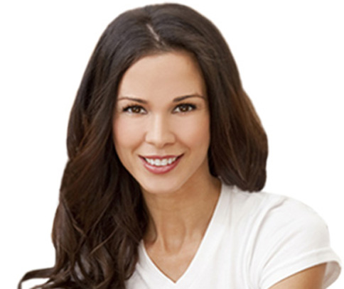 Photo of young brunette woman smiling for porcelain veneers from Plano dentist Dr. Miranda Lacy.