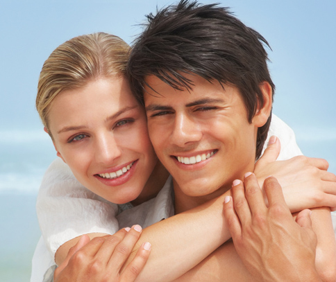 Closeup photo of couple on the beach for teeth whitening from Plano dentist Dr. Miranda Lacy.