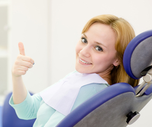 Photo of young woman in dental chair for Plano cater to cowards dentistry from Miranda Lacy DDS.