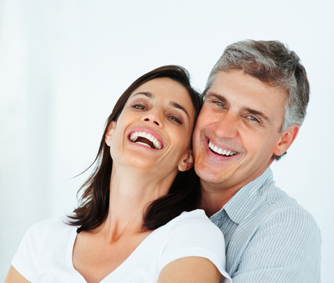Closeup of mature couple laughing for mercury free dentistry from Plano dentist Miranda Lacy DDS.